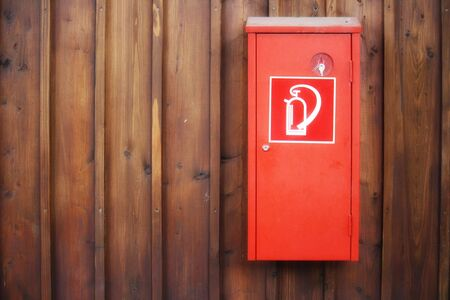 Extinguisher with wood background photo