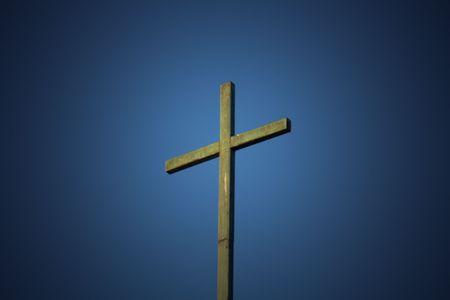 Cross against large blue sky photo
