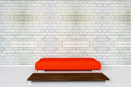 Red couch on white brick wall with empty wooden table photo