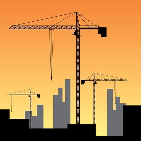 building safety: Large construction site with three big cranes.