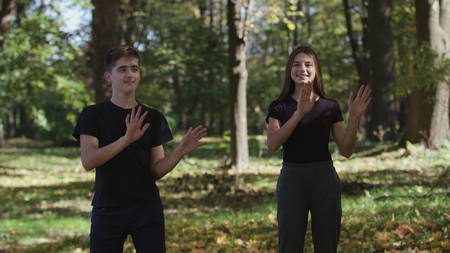 MS Boy and girl jumping and throwing dry leaves in park 4k
