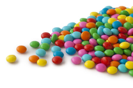 Colorful round candy on white background