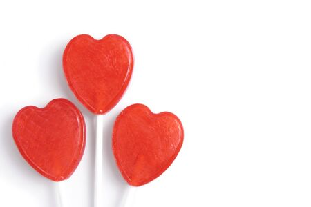 Heart shaped lollipops, isolated on white background