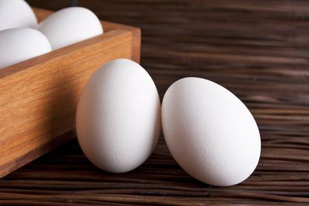 Organic eggs in wooden box