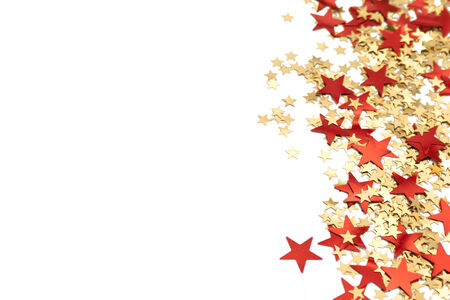 Red and golden Christmas stars on white