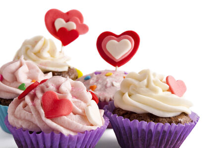 Four Valentine decorated cupcakes isolated on white Stock Photo