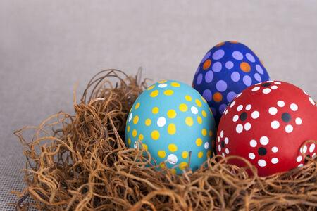 Three beautiful Easter eggs on nest  Stock Photo