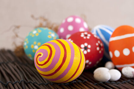 Colorful hand painted Easter eggs on wood