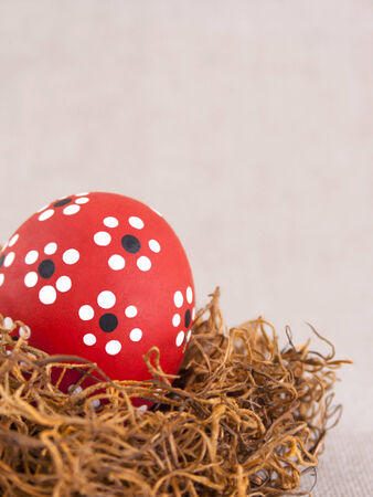Red Easter egg on nest Stock Photo