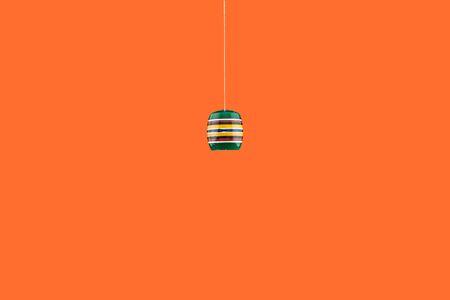 cup on orange background Фото со стока