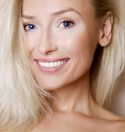 Portrait of beautiful smiling woman with clean skin. Pure beauty.