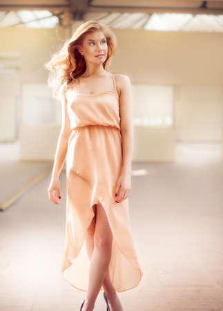 maxi dress: Fashionable delicate woman walking in beautiful maxi dress, looking away. Summer time.