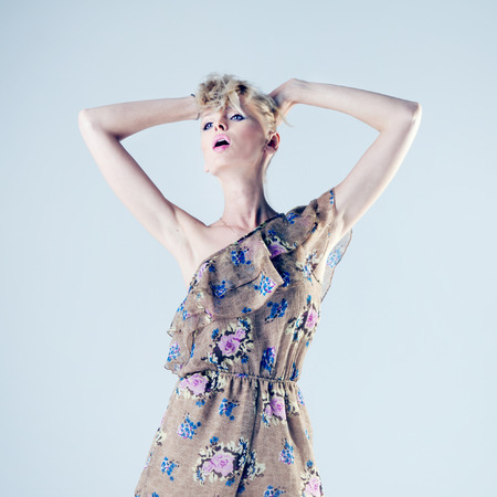 Fashionable attractive beautiful blonde woman posing in studio.