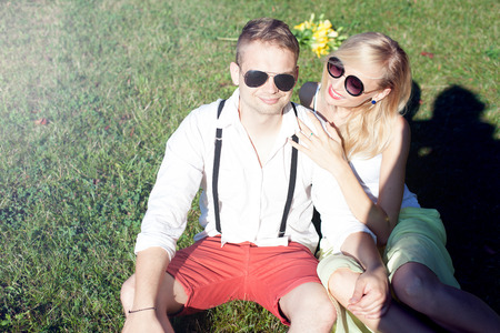 Beautiful young couple on a date in sunny summer day. Stock Photo