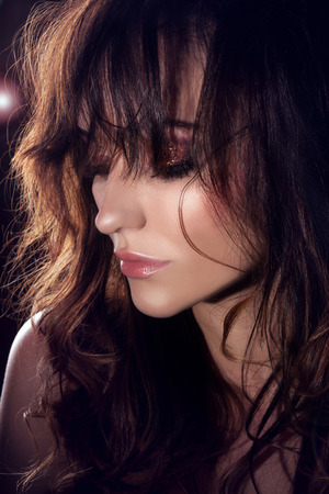 Beauty portrait of delicate attractive brunette woman with perfect makeup. Girl with closed eyes photo