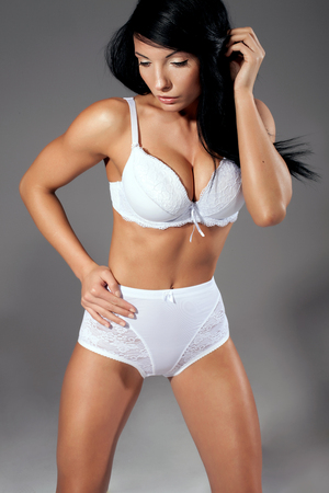 perfect fit: Delicate sexy woman with perfect fit body posing in sensual lingerie. Stock Photo