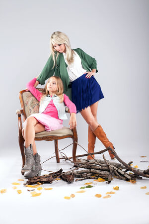 Beautiful mother posing with daughter in studio. Fashion photo.Winter style. photo