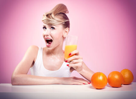Smiling beautiful woman drinking orange juice. Happy healthy girl. photo