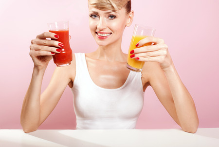 Smiling beautiful woman drinking healthy juice. Happy healthy girl. photo