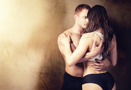 nude young: Sexy couple posing in  studio. Handsome muscular man with girlfriend.