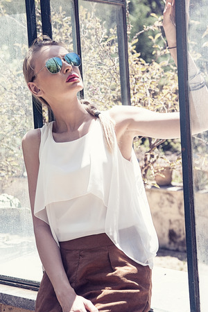 sunglasses: Portrait of beautiful blonde woman wearing sunglasses.