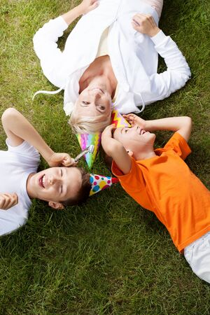family and friends: Happy mother with her sons, birthday party in garden. Outdoor photo. Stock Photo