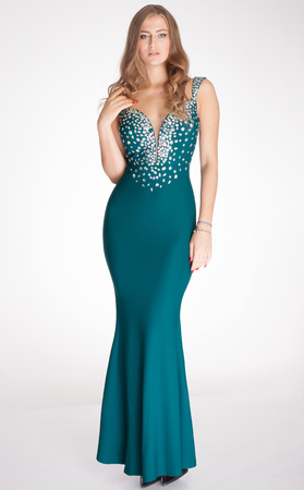 Elegant beautiful woman posing in fashionable evening dress, looking at camera. Studio shot.