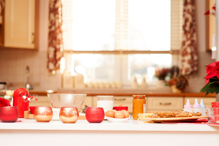 Gingerbread baking in bright kitchen. Christmas time.