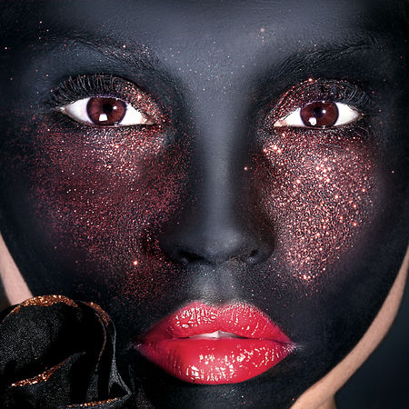black makeup: Beauty portrait of woman with creative makeup. Black mask. Brown eyes. Girl looking at camera.