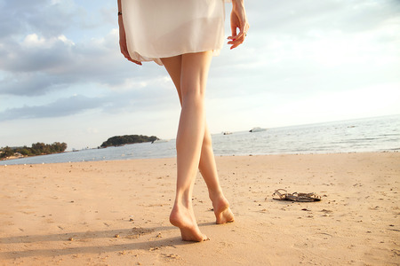 bare girl: Beautiful woman legs on the beach, Thailand. Stock Photo