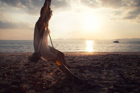 spiritless: Romantic woman spending time on the beach. Sunset. Summer time. Thailand. Stock Photo
