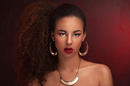 african american nude: Fashion photo of beautiful elegant african american woman. Girl posing in jewelry, wearing fashionable earrings and necklace. Beauty portrait. Studio shot.