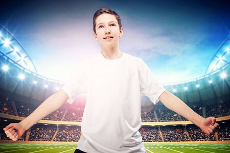 little league: Young soccer player posing on blue background, wearing sportswear