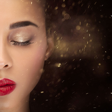 Conceptual photo of young african american woman with glamour makeup.