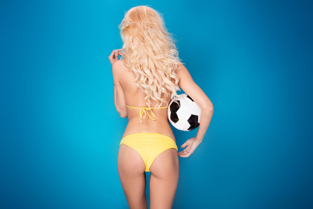sensuous: Sexy blonde woman as a soccer player. Fit body shape.