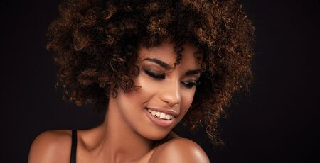 girl  care: Closeup beauty portrait of young african american girl with afro and glamour makeup.