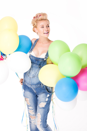 parentage: Happy pregnant woman posing in studio with colorful balloons. Stock Photo