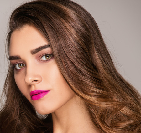 Fashion studio photo of  beautiful young lady . Beauty portrait of attractive girl. Perfect face makeup. Imagens
