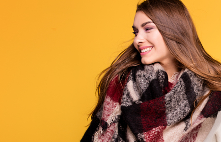 Beautiful Fashion Young Model Wearing Fashionable Clothes On Yellow Background. Autumn style. Brunette girl.