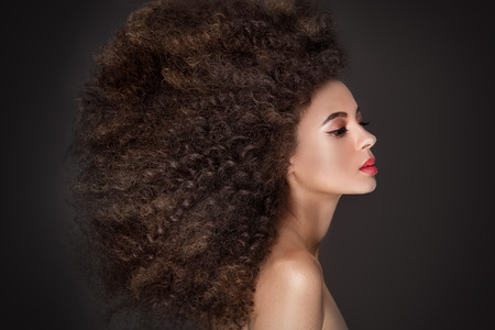 glamour makeup: Beauty portrait of african american woman with afro hairstyle and glamour makeup.
