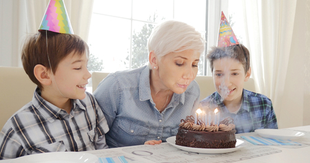 Mother and her sons celebrating birthday. Stock Photo