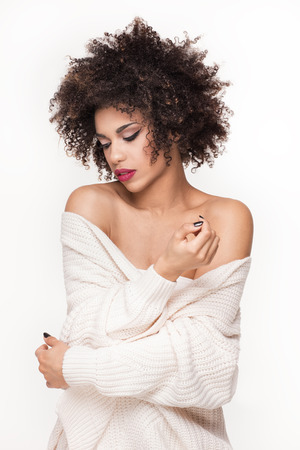 Beautiful sensual African American woman with afro hairstyle and glamour makeup on white background. Standard-Bild