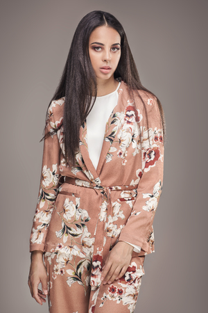 brazilian ethnicity: Fashionable young african american woman with glamour makeup and long hair posing in studio.