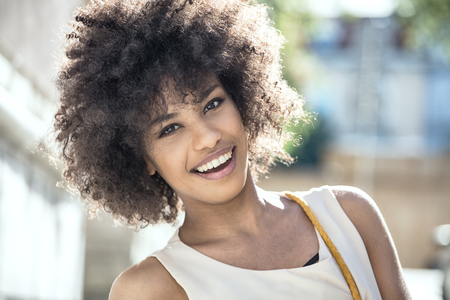 Portrait of smiling beautiful african american girl with afro hairstyle.