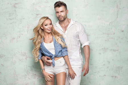 Beautiful caucasian couple posing together. Summer style. Stock Photo
