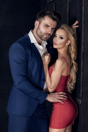 Elegant sexy couple posing together. Stock Photo