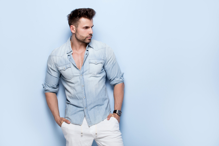 Handsome man posing in jeans shirt.