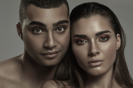 Beauty portrait of sensual beautiful couple. Caucasian woman with glamour makeup posing with handsome african american man.