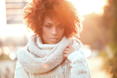 Autumn outdoor portrait of beautiful african american girl with afro hairstyle. Stock Photo