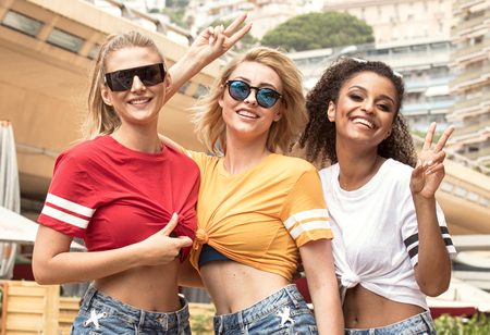 Group of beautiful young multiracial girls having fun in Monte Carlo, Monaco.
